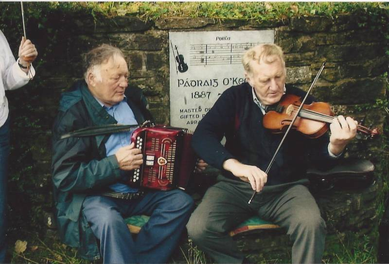 Caption – Timmy Collins, Newmarket and Paddy Jones, Castleisland at the Birthplace of Padraig O' Keeffe, Ballydesmond